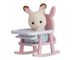 Кролик в детском кресле